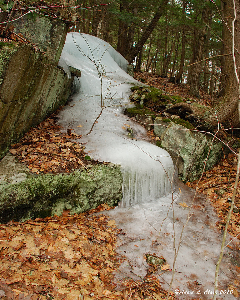 03.13.2010<br /> <br /> While out investigating an area for future exploration, I saw this ice running down over the rocks