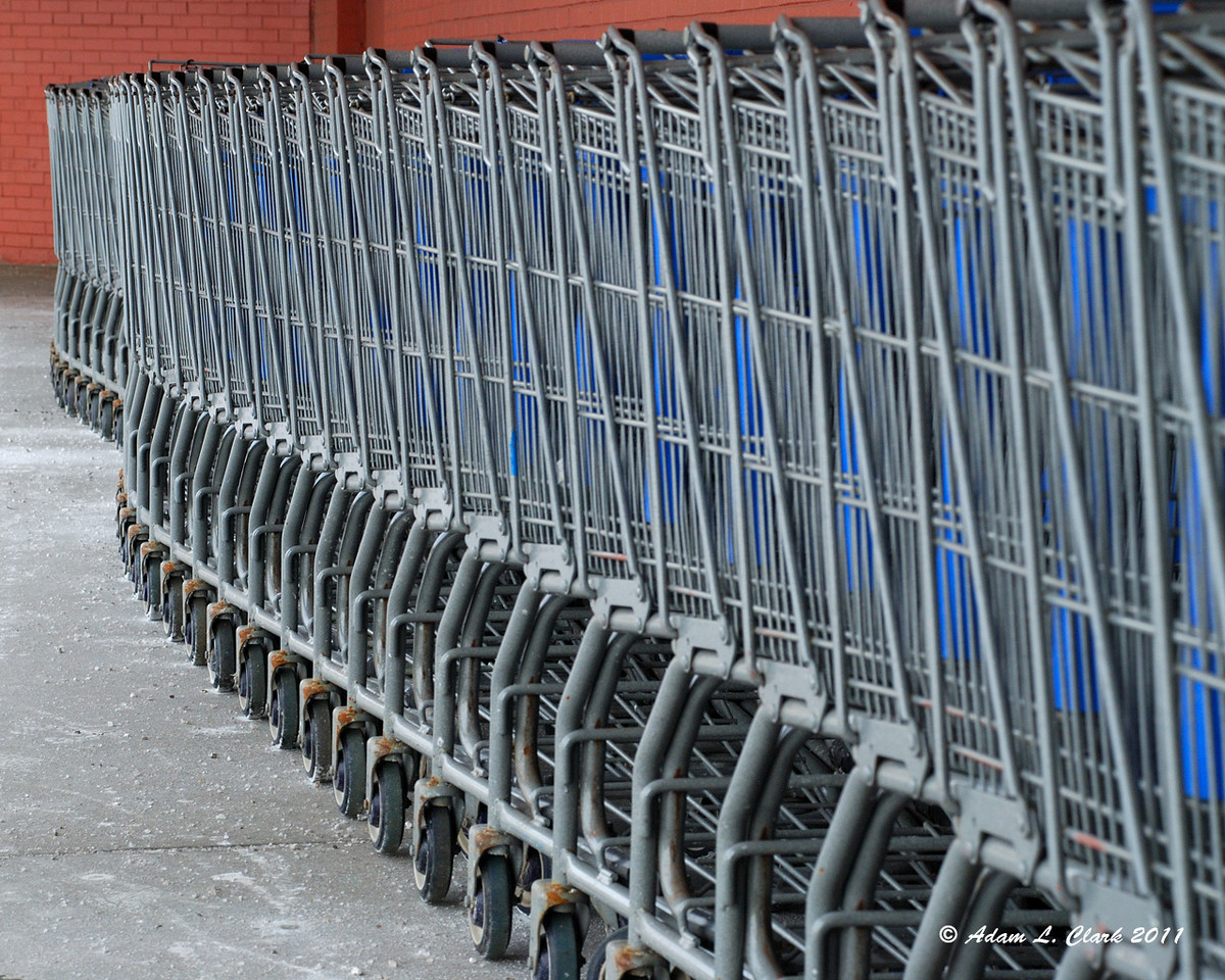 02.15.2011  A row of shopping carts outside of the local Walmart